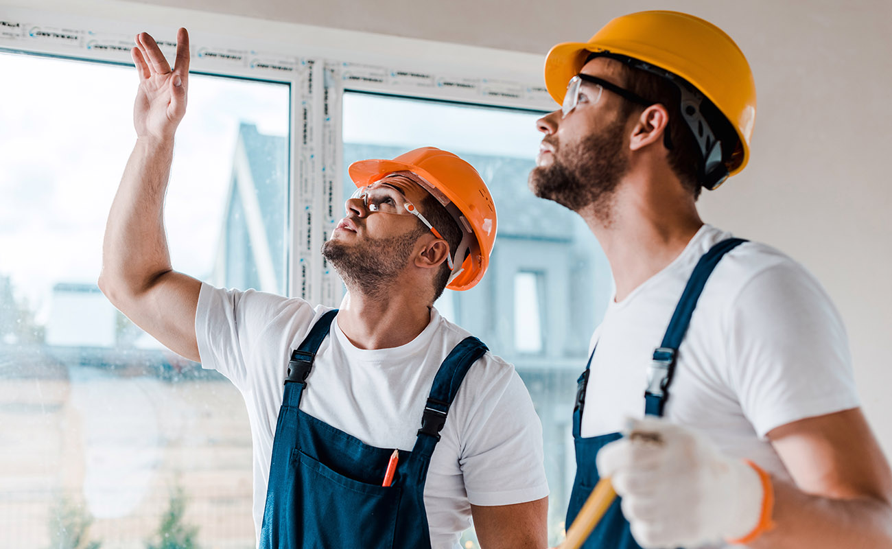 Construction workers remodeling a house.