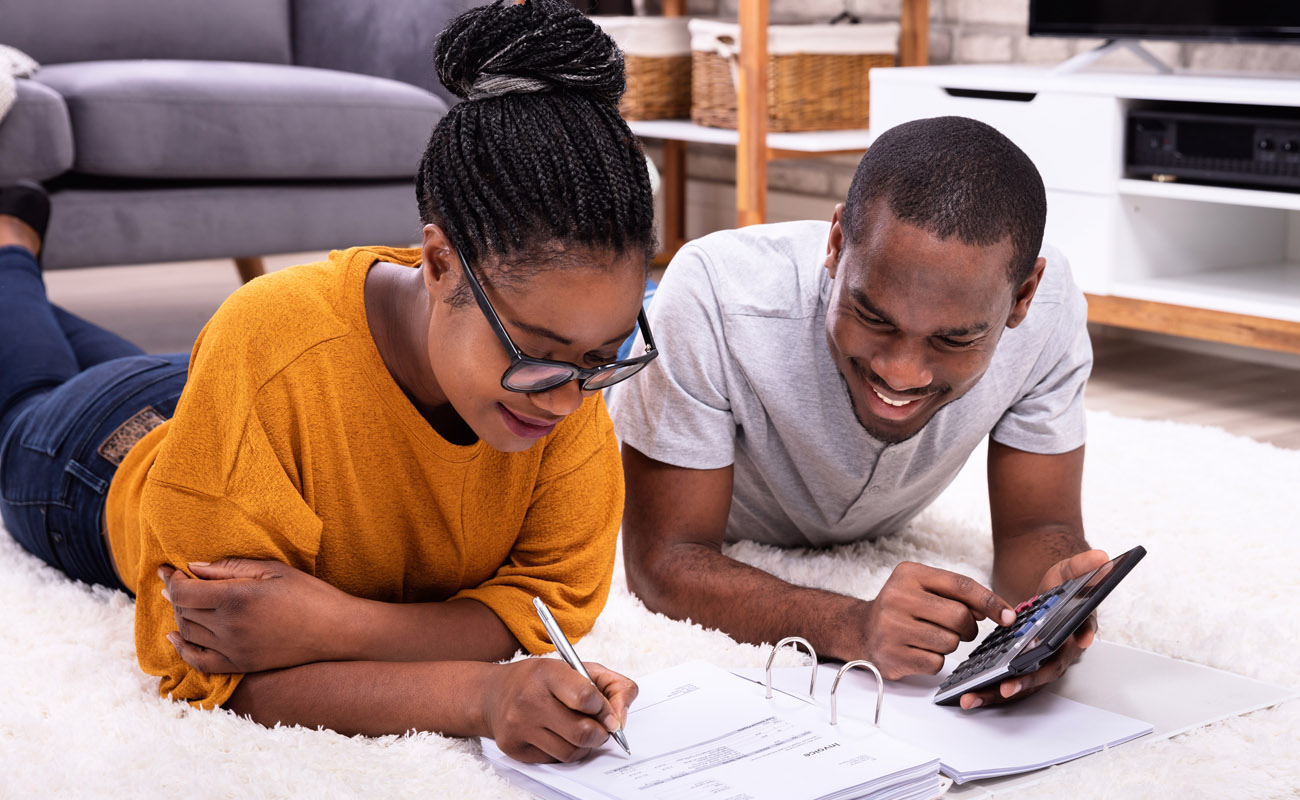 Couple calculating extra payments.