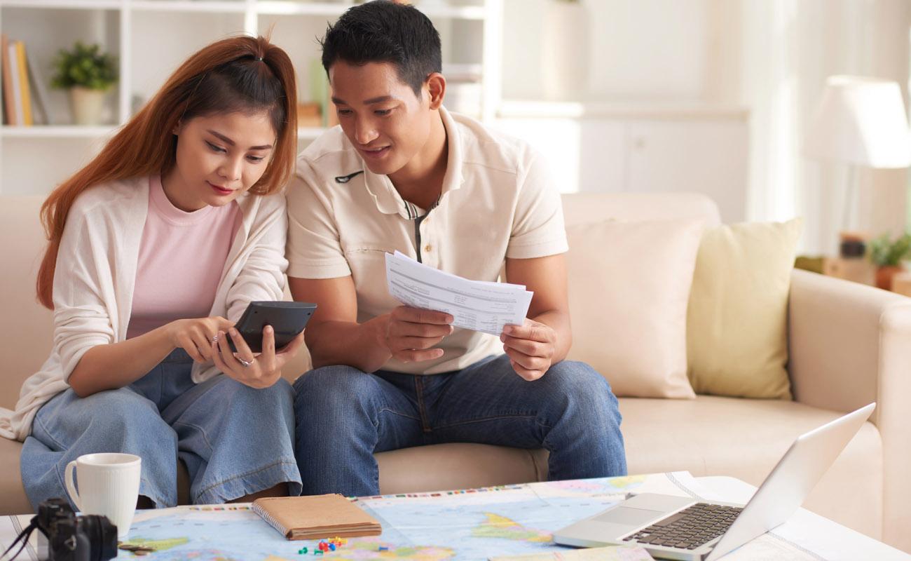 Couple calculating finances.
