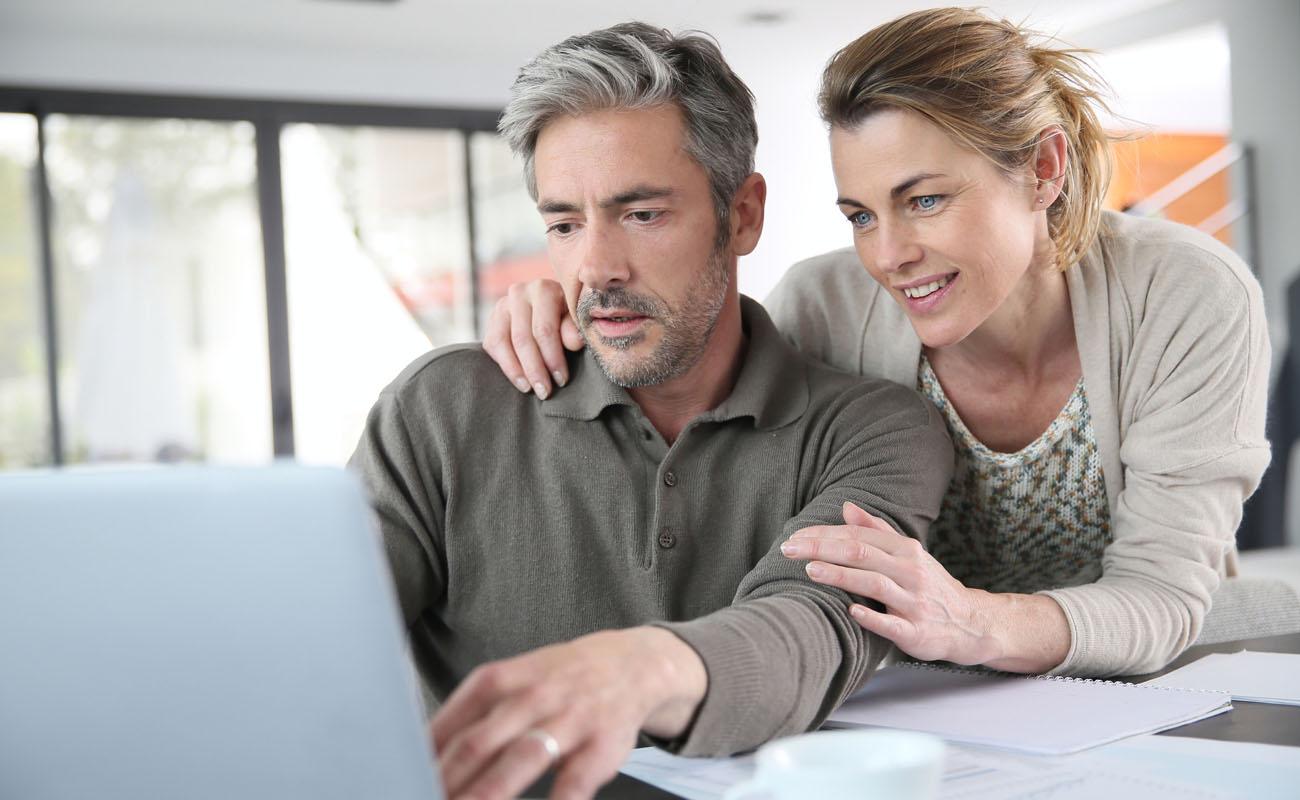 Couple calculating mortgage savings.