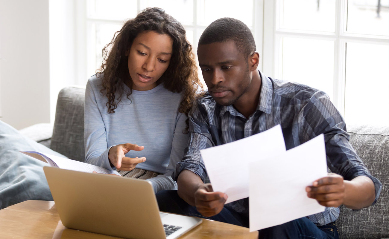 Couple comparing mortgage deals.
