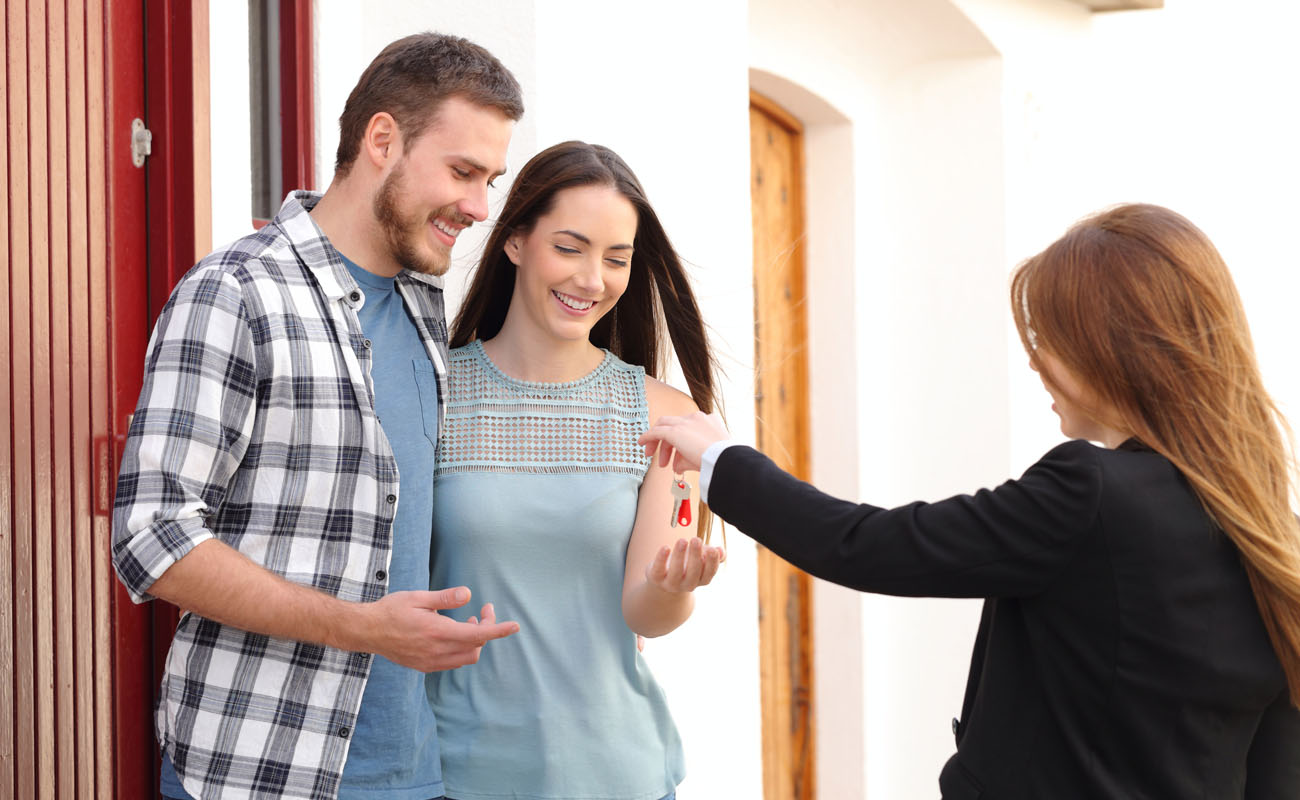 Couple getting keys to a new house.