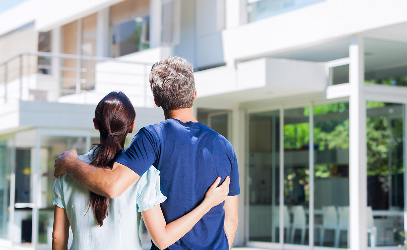 Couple looking at house for sale.