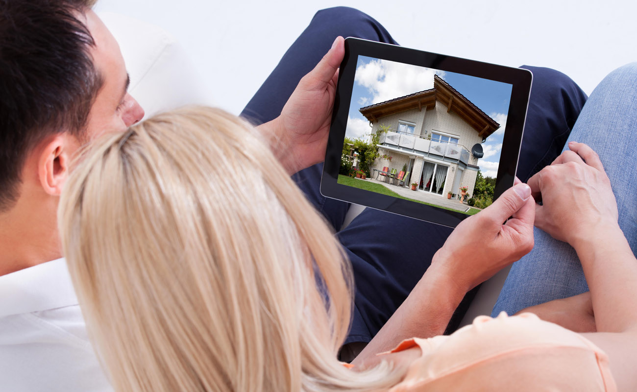 Couple looking at houses online.