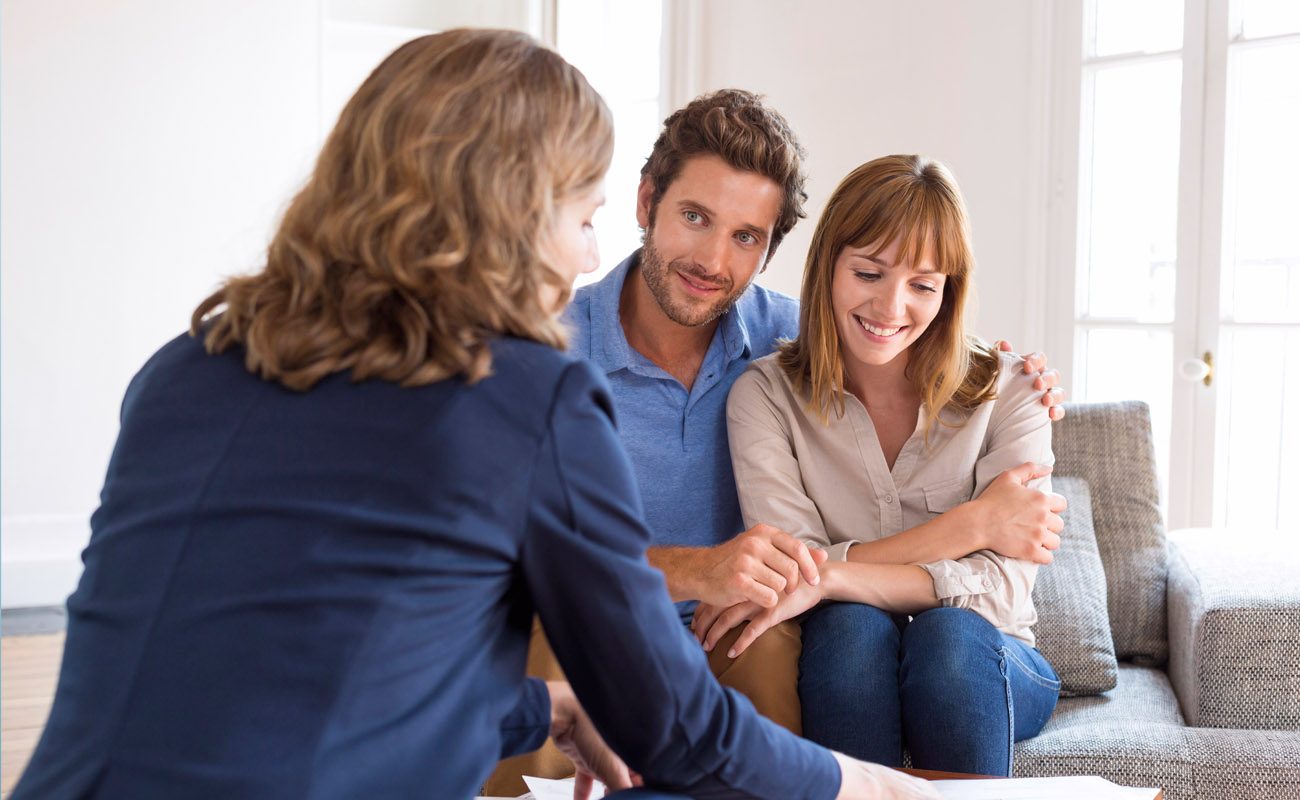 Couple meeting with a real estate agent.