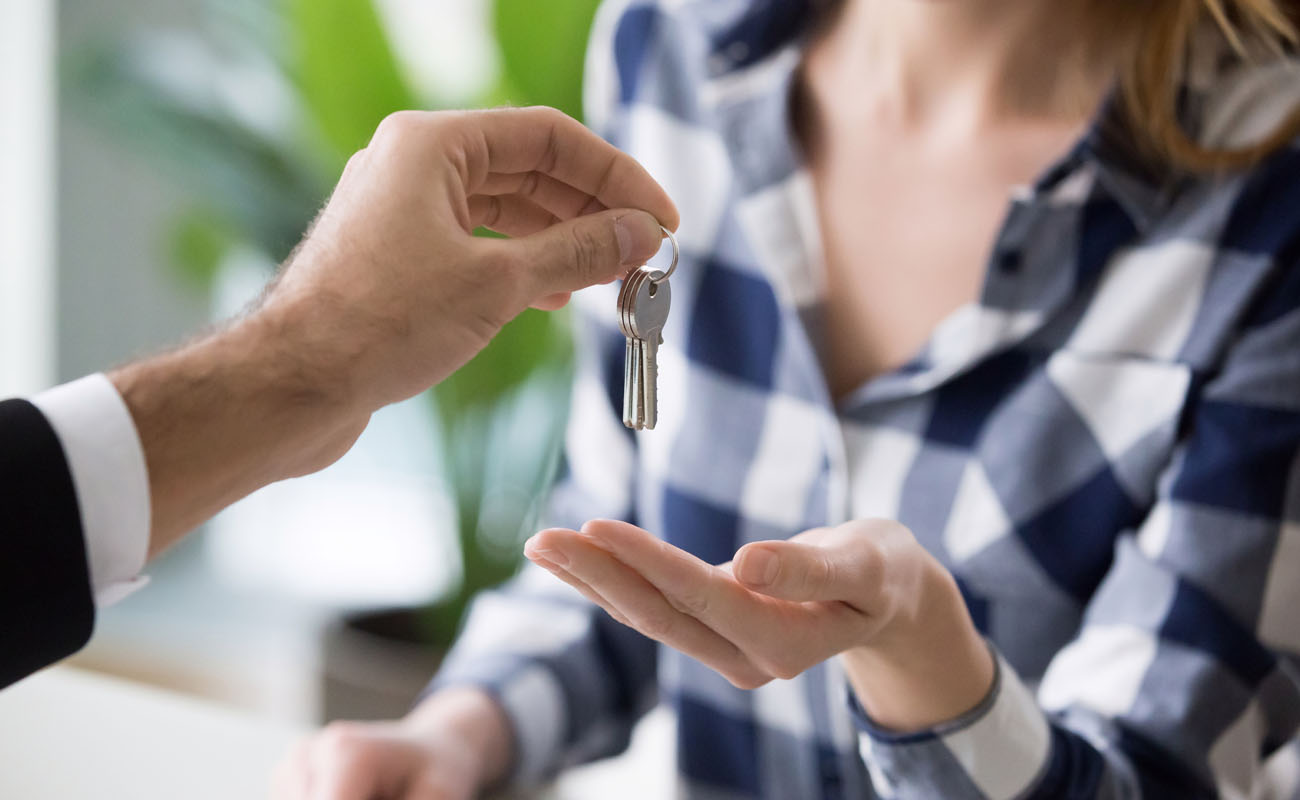 Giving keys to a lady homeowner.