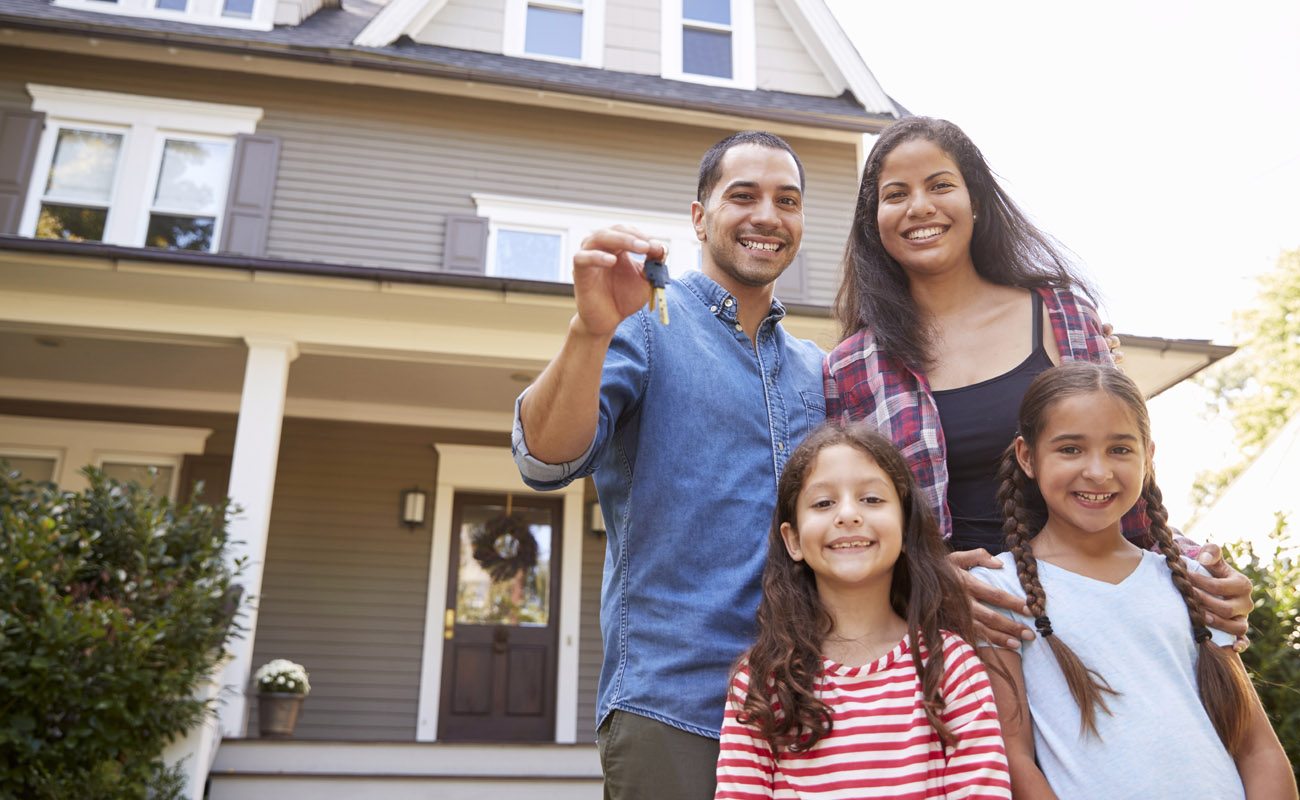 Happy family with a new house.