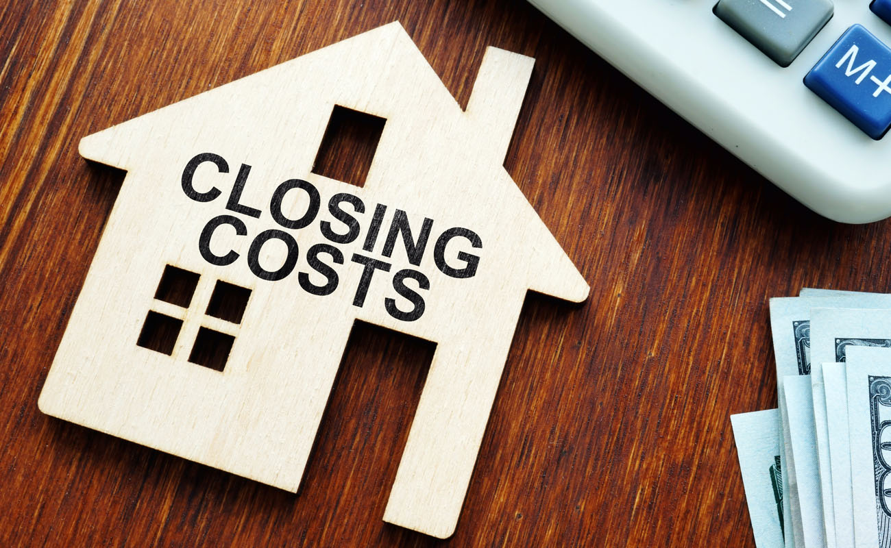 House model with closing costs sign.