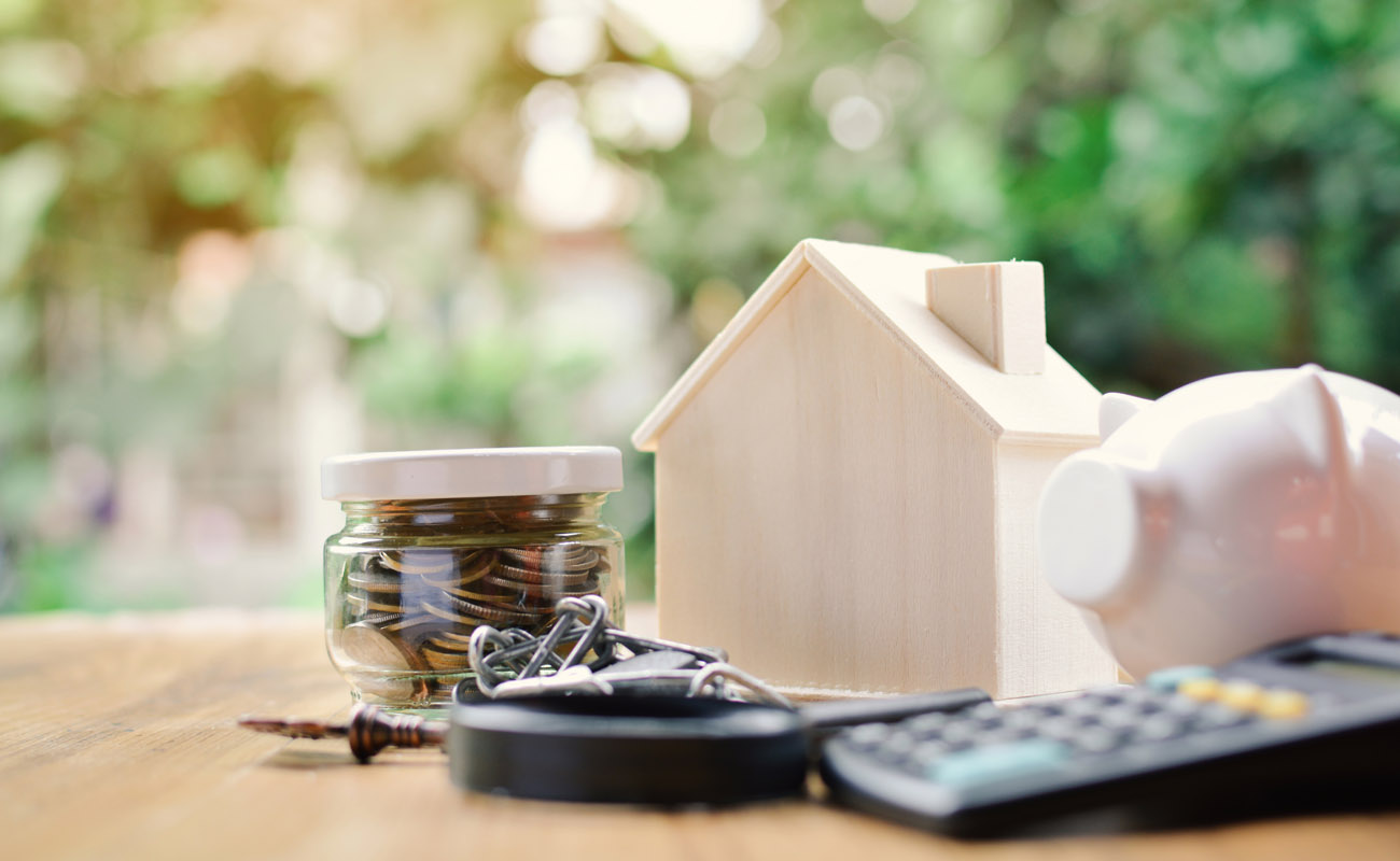 House, money, calculator, piggybank, keys.