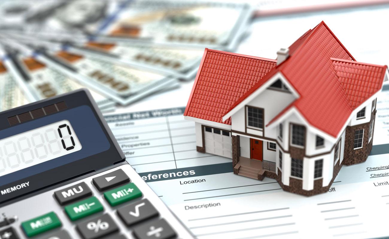House, money and calculator.