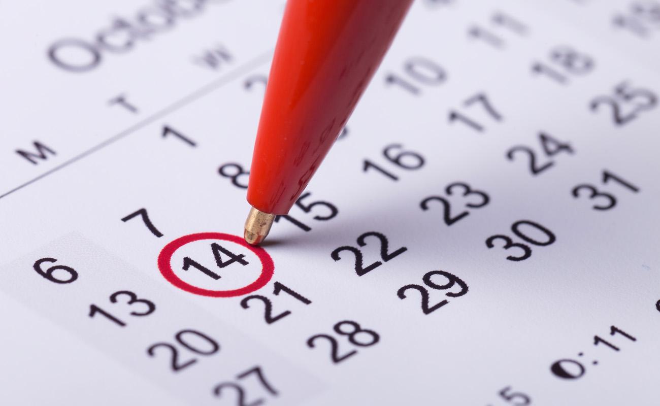 Marking dates on a calendar.