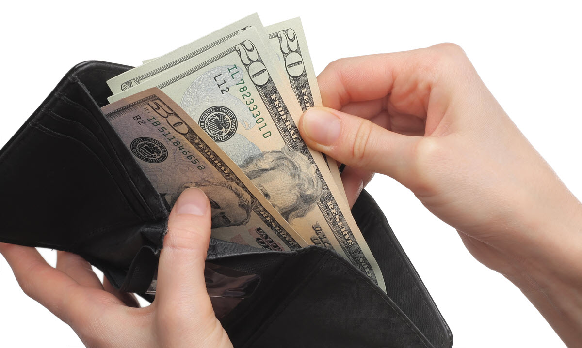 Pulling Money Out of a Wallet.