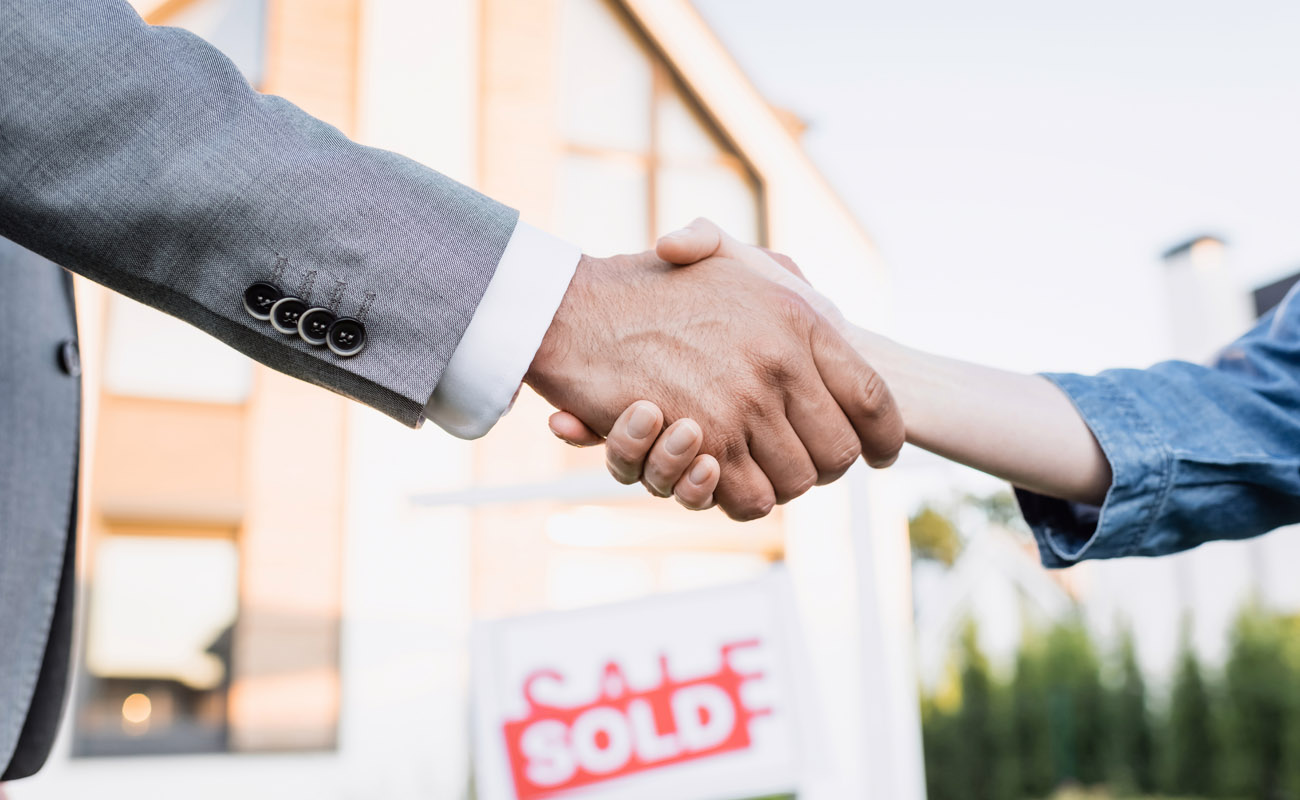 Shaking hands with real estate agent.