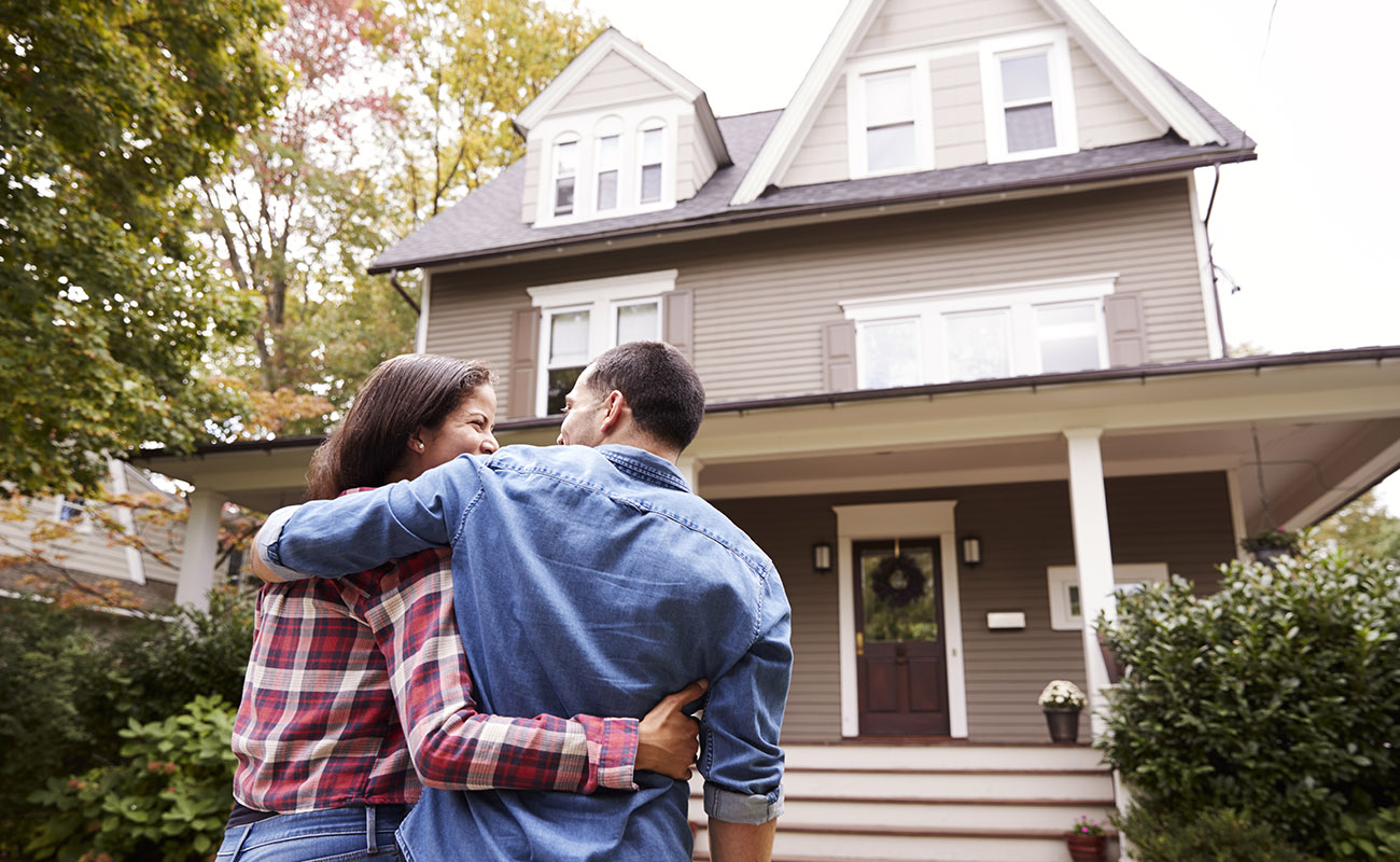 Sweet couple checking out a house.