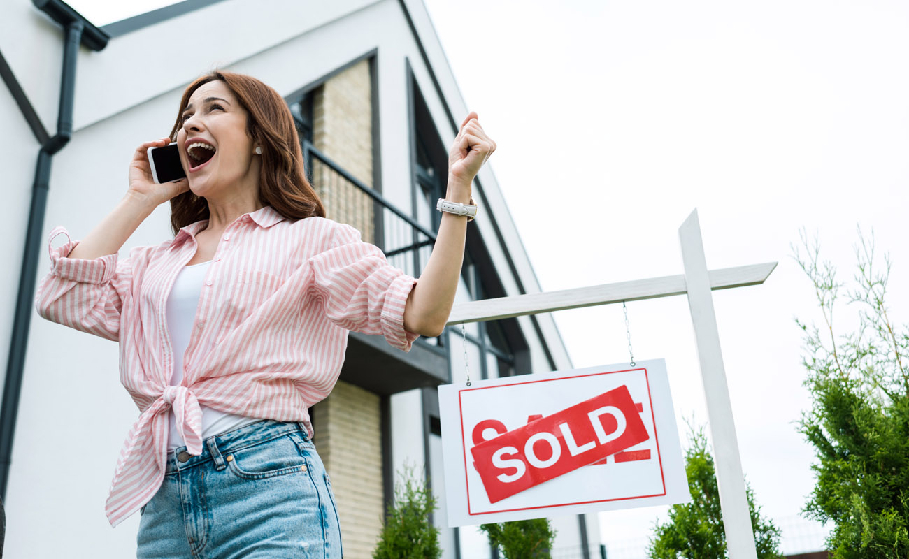Woman happy over sold house.