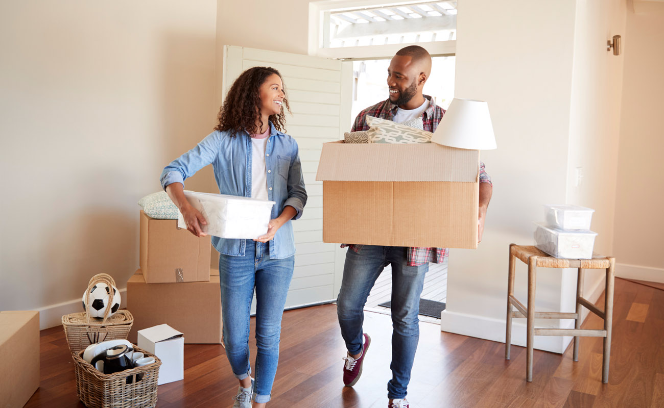 Young couple moving in a rental home.